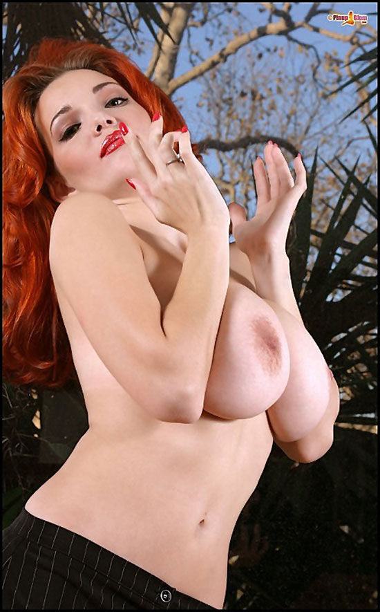 Busty Redhead Danielle Showing Tits at PinupGlam.com