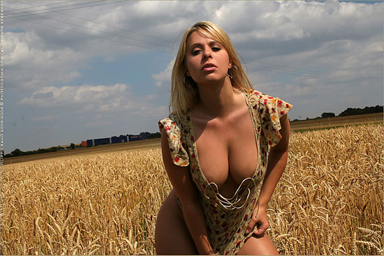 Sexy Long Legged and Busty Katerina Hovorkova In The Field at PhotoDromm.com