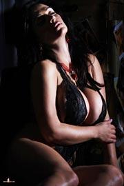 Busty Denise Milani in ultra short black underwear