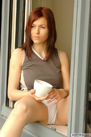 Busty Brunette Teen Iga Drinking coffee Naked at BustyBrits.com
