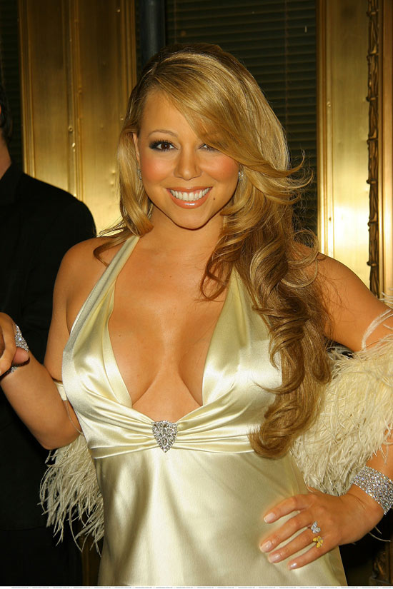 Mariah Carey showing big soft boobs in great cleavage